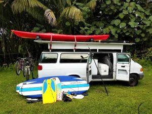 photo of rv camper van in hawaii with surfboards
