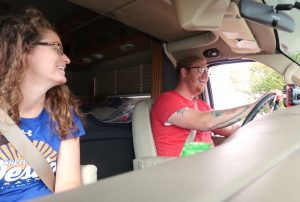 rv couple telling stories on road trip drive