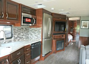 rv kitchen with a full sized fridge