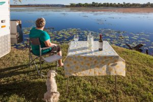 rv by lake retired dog woman wine